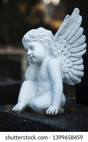 Little sad angel. Religion, faith, death, eternity concept.
