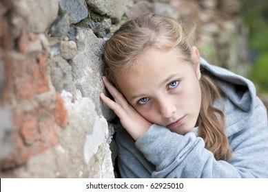 Little sad child in outdoor.