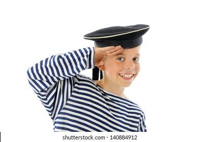 Little sailor in the sea cap salutes