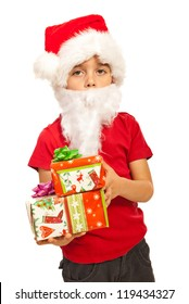 Little Santa Claus boy with white beards holding Christmas gifts isolated on white background