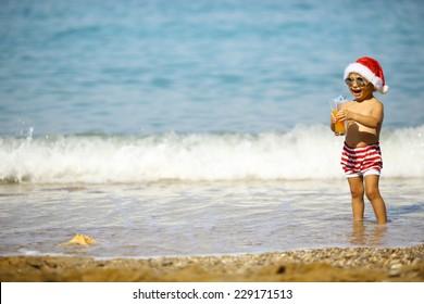 Little Santa on the beach