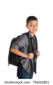 Little school boy junior going to school with backpack