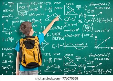 Little school boy on classroom