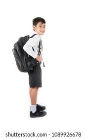 Little school boy wearing student uniform ready for first day school