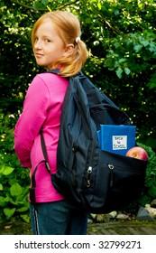 Little school girl is going back to school
