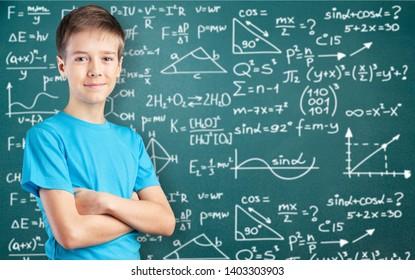Little school man on blackboard background