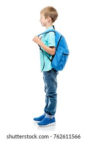 little schoolboy with backpack side view on a white background in full length