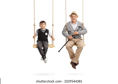 Little schoolboy and a mature man seated on swings isolated on white background