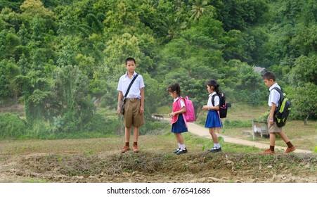 little schoolchild walking to school