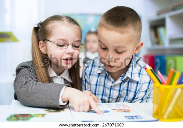Little Schoolchildren Reading Book School Stock Photo (Edit