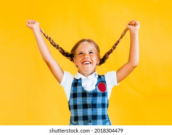 Little schoolgirl with a happy smile. Little schoolgirl in school uniform. Cute schoolgirl with long hair. Primary education. Perfect schoolgirl