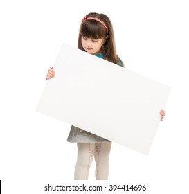 little schoolgirl holding paper blank in hands isolated on white background