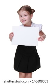 Little schoolgirl with lovely hairstyle posing with paper blank with empty space on Education concept theme/Gorgeous schoolgirl wearing white blouse and black skirt and holding paper blank