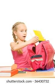 Little schoolgirl packing her rucksack