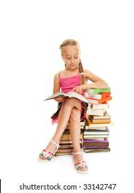 Little schoolgirl reading a book