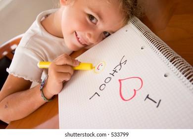 little schoolgirl showing a draw