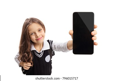 Little schoolgirl showing a phone and smiling isolated on white background