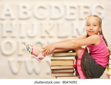 Little schoolgirl sitting