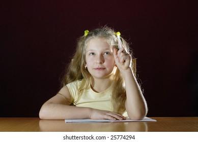 little schoolgirl is thinking about her homework