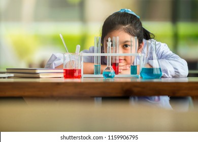 Little scientist. Children scientists making experiments in the laboratory. Educational concept.
