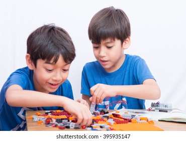 Little sibling boy playing block indoor house education