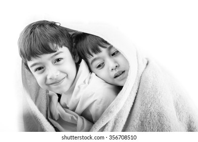 Little sibling boy with towel cover over head black and white