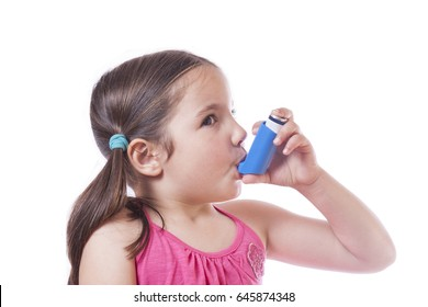Little sick girl using medical spray for breath. Isolated over white background