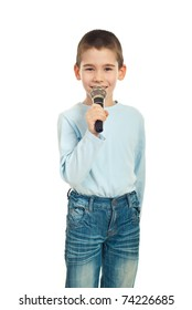 Little singer boy with microphone against white background
