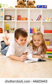 Little sister let me show you how to read - kids with books laying on the floor