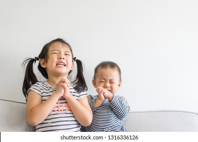 Little sister praying with her baby brother.Prayer kids want new sibling.Christian little girl and baby boy at home in Japan.Family with children at home.Christianity, Love, trust and tenderness.