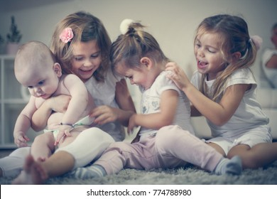 Little sisters take care baby brother. Love emotion.