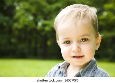 Little Smiling Baby On Natural Background