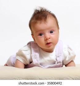 Little smiling baby on the pelt - studio shot