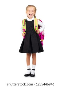 Little smiling blond girl in school uniform with pink school bag isolated on the white background