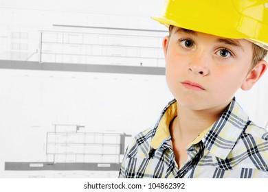 Little smiling builder in helmet. on a white background