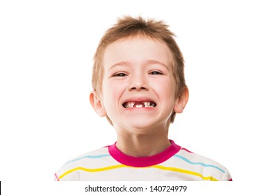 Little smiling child boy showing his first baby milk or temporary teeth fall out