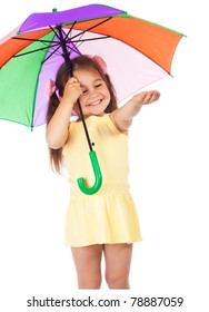Little smiling girl holding colored umbrella and checking for rain