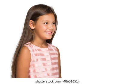 Little smiling girl isolated on white background