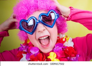 little smiling girl with pink wig and heart glasses