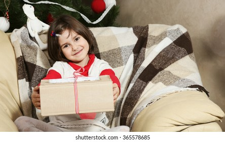 Little Smiling Girl Showing Christmas Box Gift