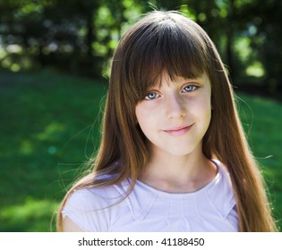 Little smiling girl summer portrait