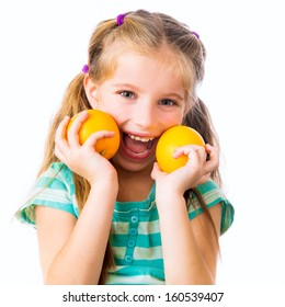 little smiling girl with two oranges isolated on white background