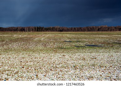 Little snow on agricultural field.