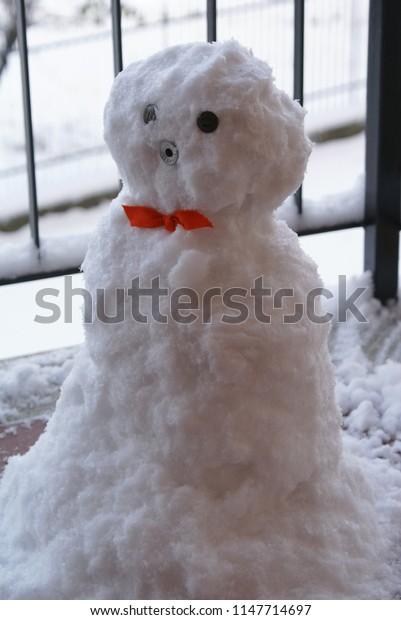 Little snowman on a balcony