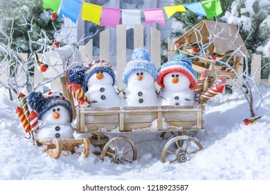 Little snowmen with fireworks on the background of a winter landscape on a sunny day