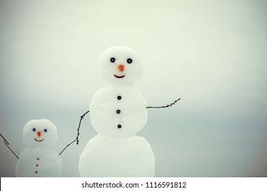 little snowmen. Love and trust. Happy holiday and celebration. New year mother or father and child from snow. Snowman family in winter outdoor. Christmas or xmas decoration.