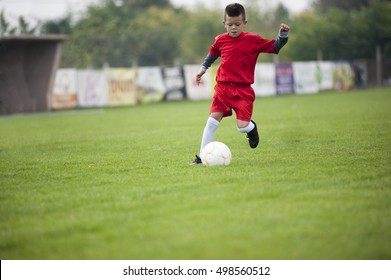 Little soccer player in action