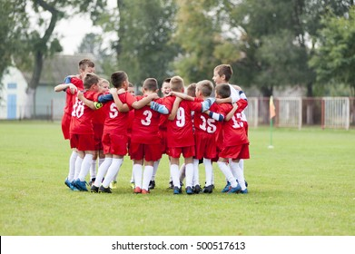 Little soccer players celebrating victory
