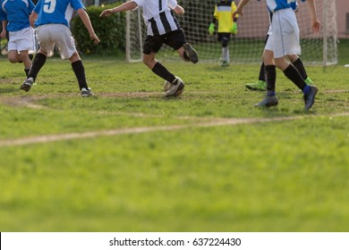 Little Soccer Players during Match: Close-up of Children's Legs