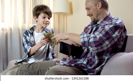 Little son asking father to give more pocket money, financial needs, fatherhood